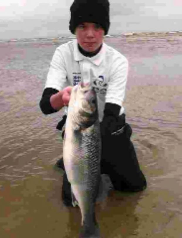 Lymington & District junior member Jaon Voller with a 6lb 8oz bass caught at Mudeford.