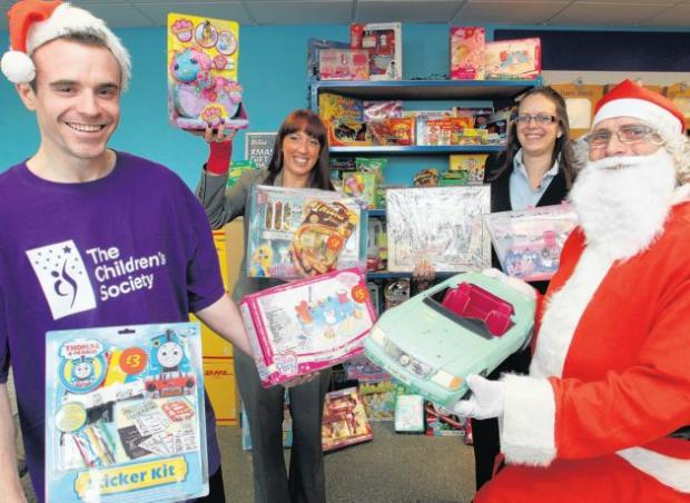 From left, Lee Sinkinson of the Children's Society, Southampton store manager Maria Baldassara, Portsmouth store manager Helen McPhail and Father Christmas.