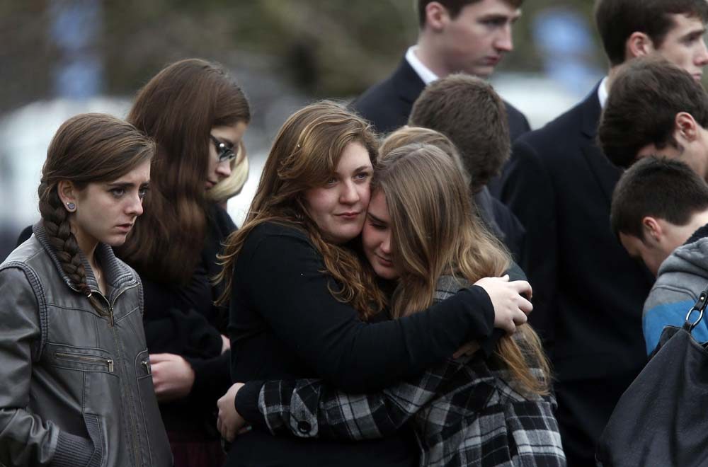 Mourners at the funeral of six year old Noah Pozner