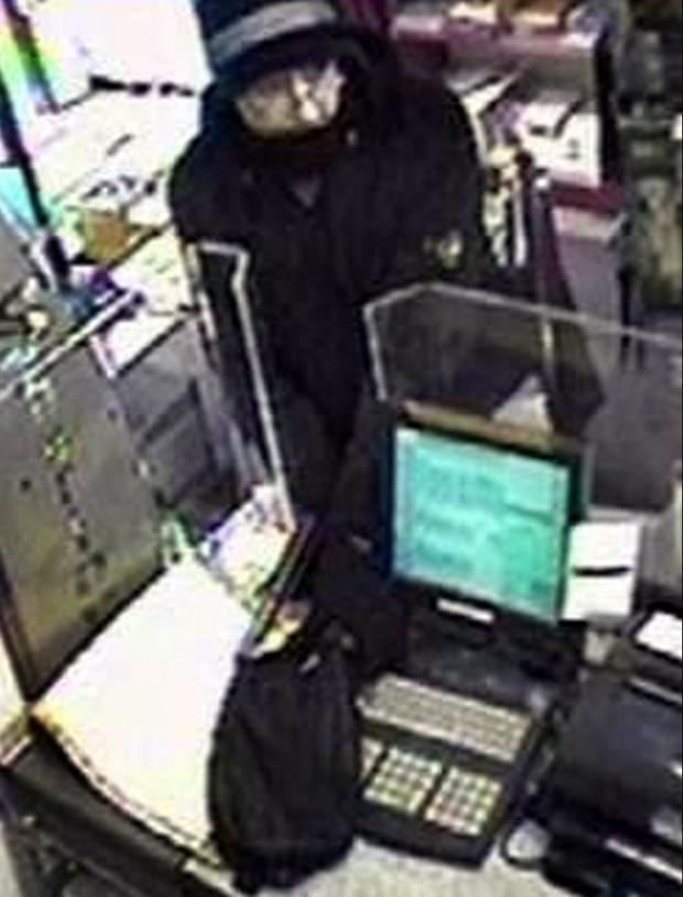 Daily Echo: The gunman caught on CCTV robbing a Post Office in Highcliffe.