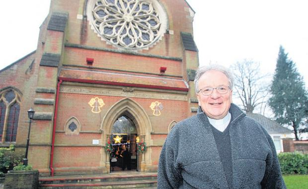 Monsignor Vincent Harvey outside St Edmund's Church. He says police will be alert to late night services.