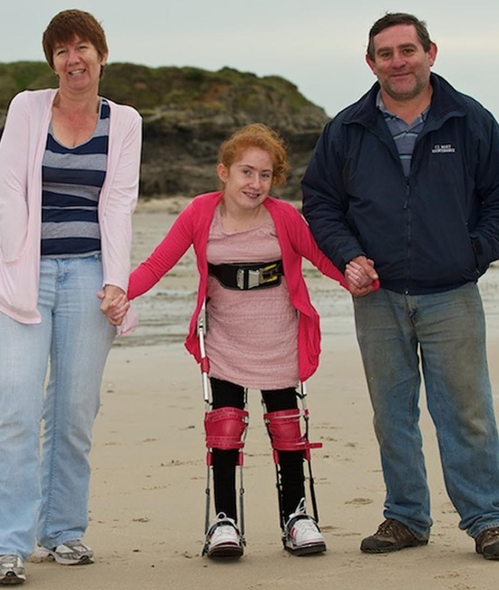 Teen told she would never walk takes first steps