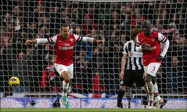 Daily Echo: Theo Walcott scores the fourth goal against Newcastle.