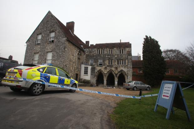 Police at the Deanery in Winchester this morning.