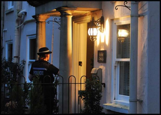 Police at the home Jim Davidson last night
