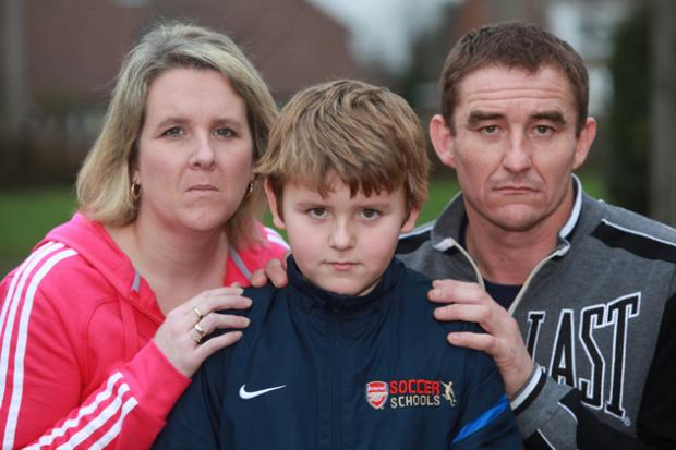 Ten year old Jordan Barnett and his mother Sharleen, and father Adrian.