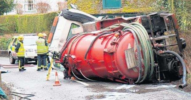 Fire crews with the stricken lorry in Leckford Lane, Stockbridge.