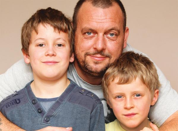 Daily Echo: Gerald Drabble with his sons Aaron, left, and Owen who are campaigning to increase government funding into cancer research and care after Gerald's wife Becki