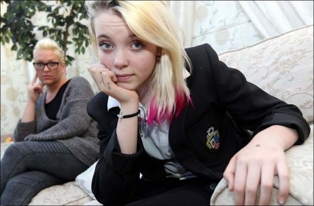 Mum removes daughter, 13, from school, after she is punished for pink hair