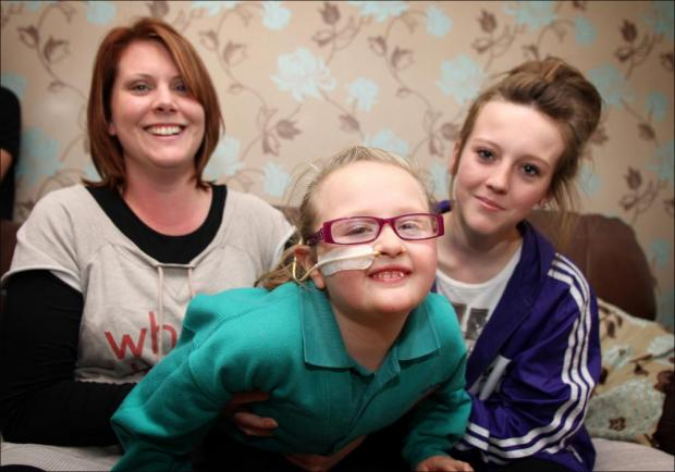 Emma Bennett (left) with daughter Natasha (right) who relies on the project to help look after her sister Kiera.