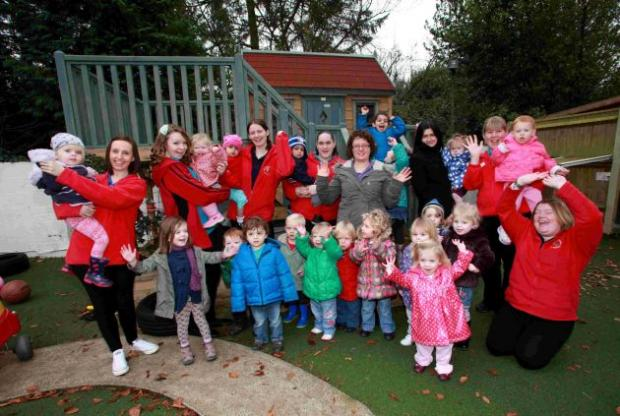 Staff and children celebrate at Paint Pots nursery