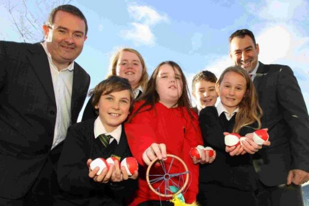 Bitterne Park pupils with Hendy Honda's Mark Busby and sixth form deputy head Mr Pan Panayiotou