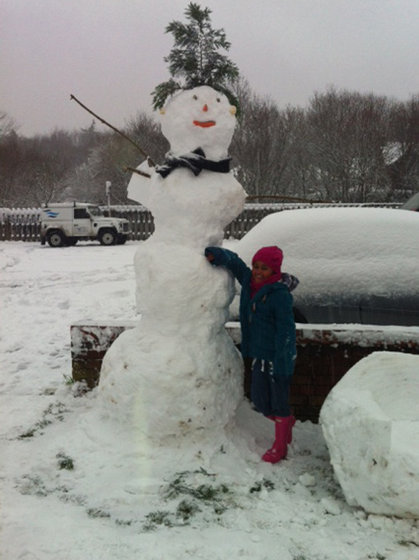 Daily Echo: Amelia Davies with a giant snowman.
