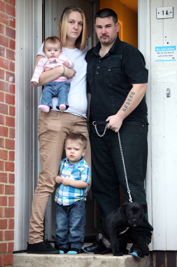 Wayne Brett with Danielle Hart, childen one-year-old Thomas Hart and three-month-old Lola Brett and dog Hunter.
