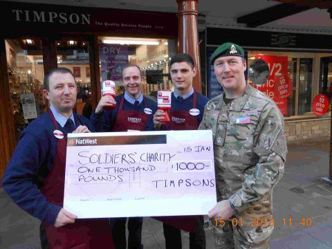 Timpson staff Scotty Tallack, Simon Baker and Gordon Murphy present the cheque to Sgt Maj Ben Culleton