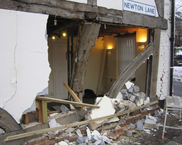 Car ploughs into historic building