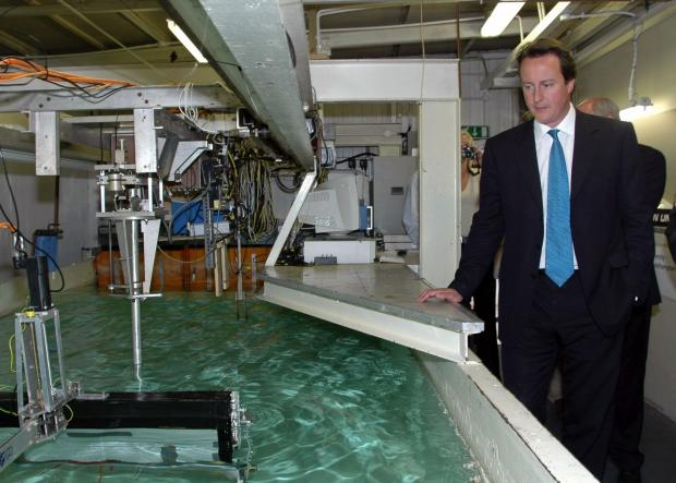 David Cameron examines  technology for harnessing wave power on a visit to the University of Southampton