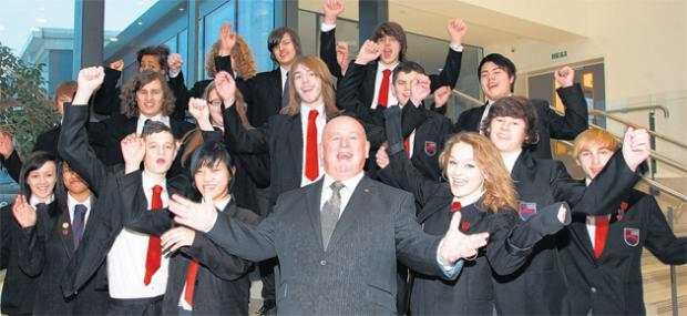 John Toland, head of Mayfield Oasis Academy, celebrates the school's GCSE league table results with pupils.