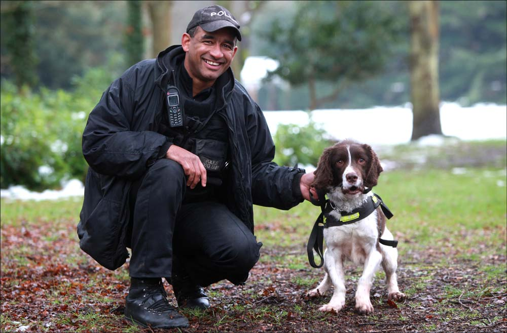 Tosh with his handler PC Guy Hall