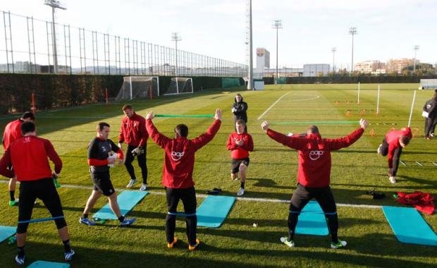 Saints players are put through their paces at Barcelona's training ground.
