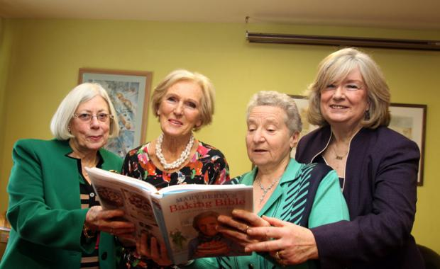 COOKERY BOOK: Mary Berry, second left, signs her book for WI members, from left, Maureen Leveson, Brenda Fletcher and Jean Johnson.