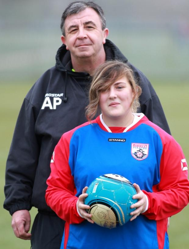 Teenage girl at centre of study on playing football with boys