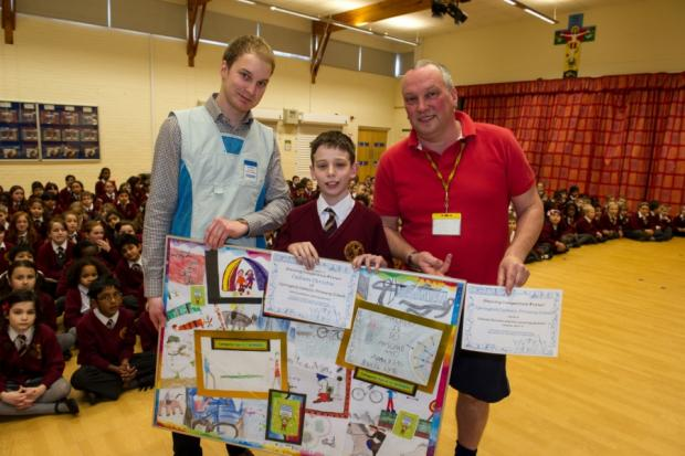 Callum Christie with Chris Allen, from Decathlon, and PE teacher Mike Cowap from Springhill Catholic Primary School.