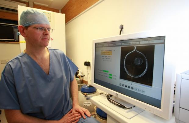 Tony Price watches the development of an embryo in the new machine.
