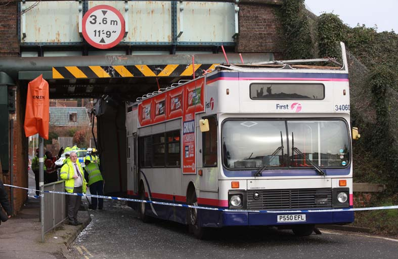 Bus roof ripped off after crashing into railway bridge