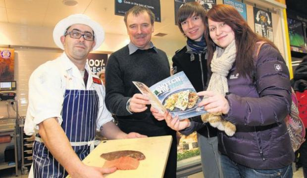 Pedro Silva on the Sainsbury's fish counter serves fish to MP Alan Whitehead, Will Yeong and Karolina Kacevaite.