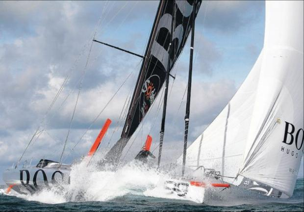 Alex Thomson aboard his yacht Hugo Boss
