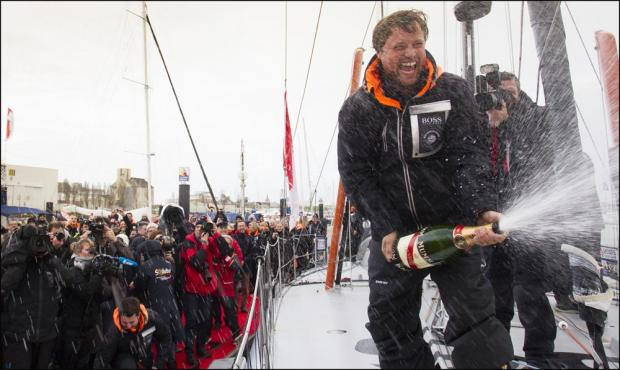 Alex Thomson celebrates as he completes the race.Picture: Mark Lloyd