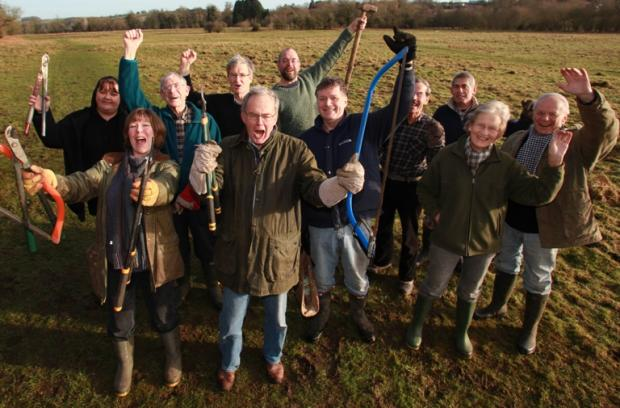 Villagers celebrate preserving precious field