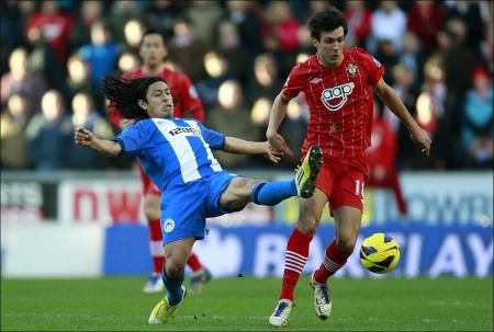 Images from the Premier League match between Wigan Athletic and Saints. The unauthorised downloading, copying, editing, or distribution of this image is strictly prohibited.