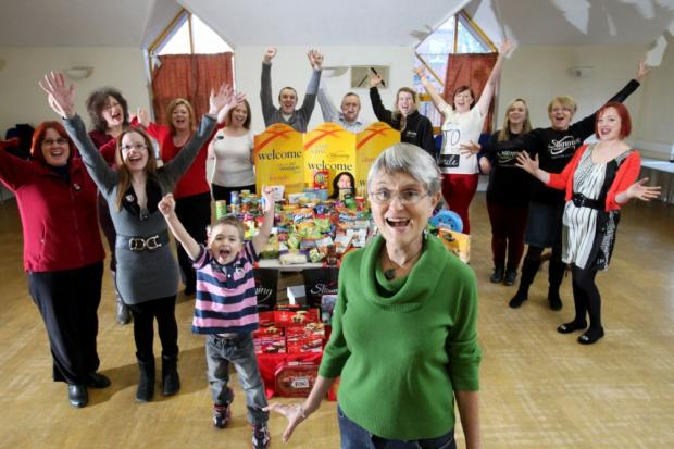 Trustee of Winchester Churches Nightshelter Jo James, front, at the handover of Christmas food-related presents.