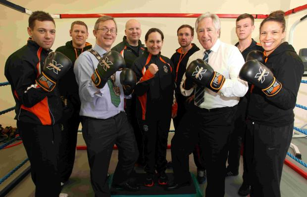 Mayor of Eastleigh, Cllr Rupert Kyrle, left, and chairman of Hampshire Cricket, Rod Bransgrove, with referee Lucy O'Connor, centre, a coach at Poseidon Boxing Club, with other coaches and boxers at the launch of Hampshire Cricket Community Trust.