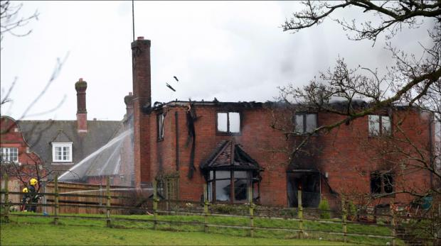 The fire damaged house at Stroud School