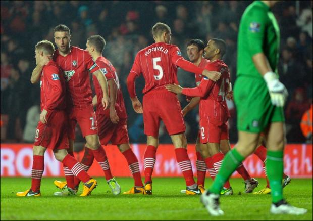 Rickie Lambert celebrates with team mates after Saints third goal.