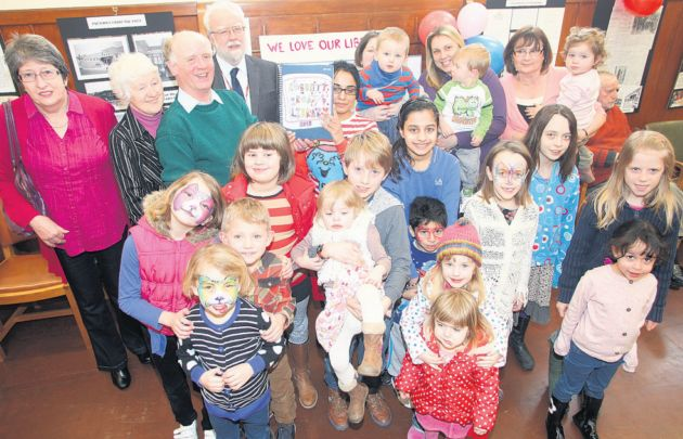 Campaigners at Cobbett Road Library hand over their 500-name petition on Saturday.