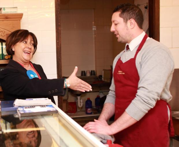 Conservative candidate Maria Hutchings on the camapign trail at a butchers