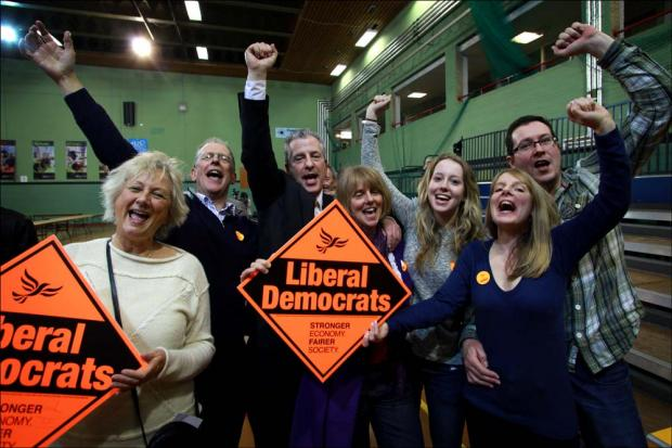Liberal Democrat Mike Thornton celebrates with his family.