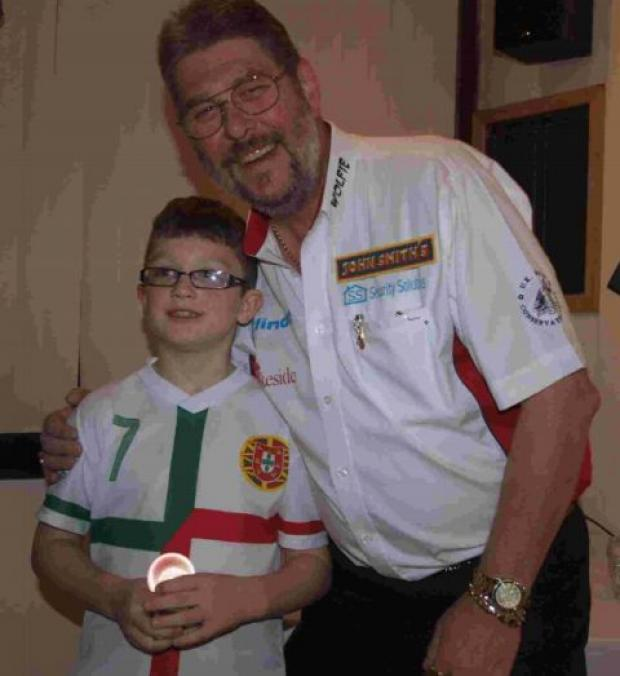 England darts star Martin Adams with nine-year-old John Tasker