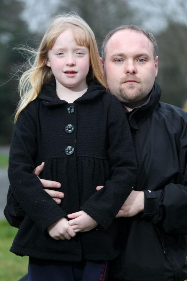 FRUSTRATED: Kirsten Hopson, seven, with her father, Perry
