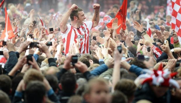 Saints striker Rickie Lambert celebrates promotion with fans