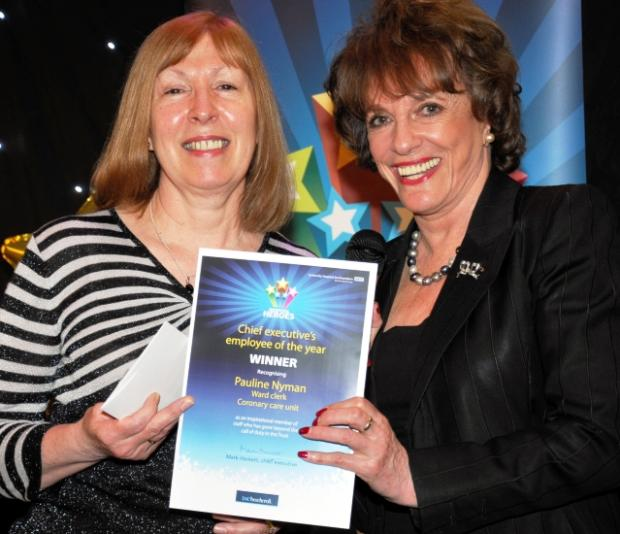 Employee of the Year Pauline Nyman receives her award from Esther Rantzen