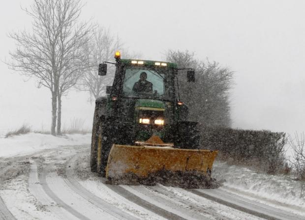 Clearing the snow from roads in Kent yesterday