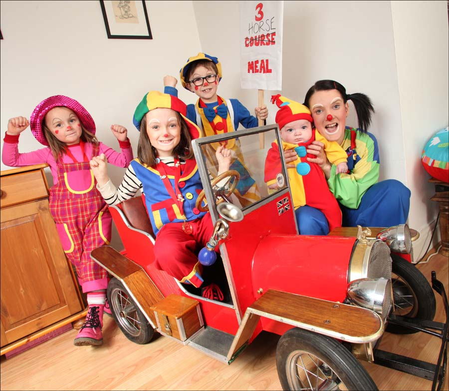 Crazy M and her team of clowns – left to right, Annie-Annie (Annie Mayo) 4, Bee-Bee (Demi Le Huray) 7, Jokey Joe (Joe Mayo) 8 and Crazy M (Emma Le Huray ) with baby Alfredo (Alfi Le Huray) four months