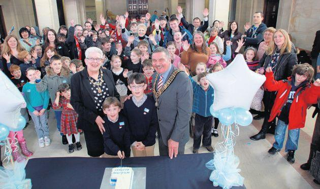 William and Henry Ward cut the birthday cake with mayor and mayoress Cllr Derek and Christine Burke.
