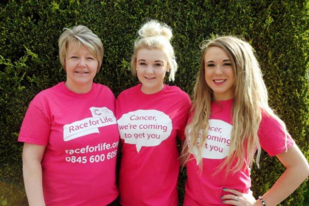 GIVING BACK: Rebecca, centre, with her mum Julie and sister hayley