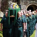 Hundreds attend funeral of ambulance driver
